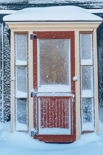 door in a snow storm