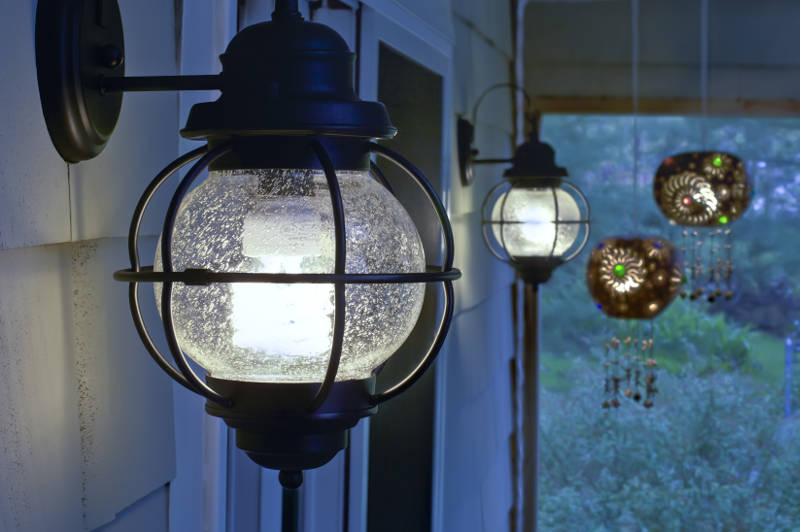 lantern lights on a front porch