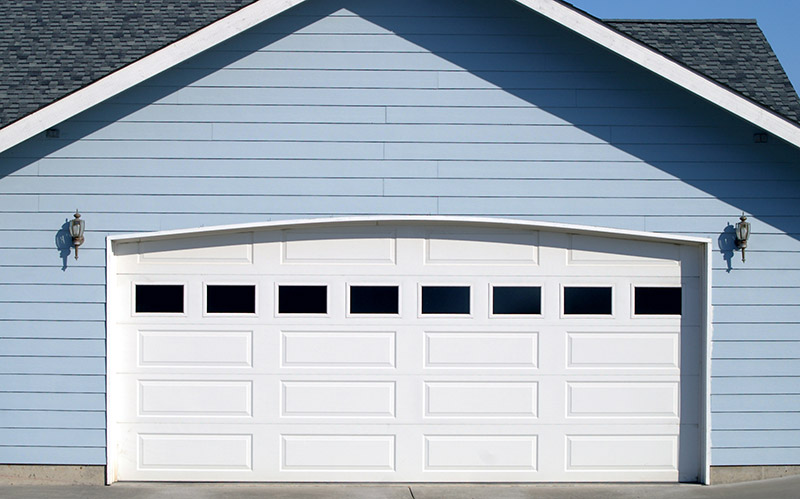 replace your garage door to prevent garage door leaks